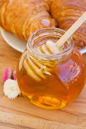 honey for breakfast    - glass  jar with stick  close up photo