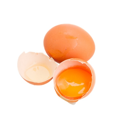 whole and broken eggs isolated on white photo