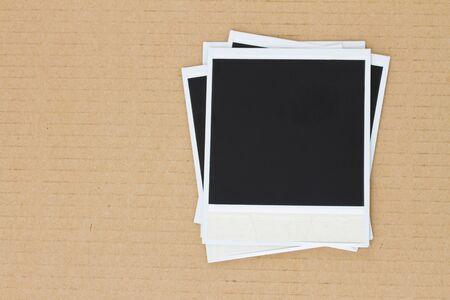 pile of blank instant photo on carton background photo