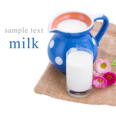 jag: milk served in pitcher and glass isolated on white background Stock Photo