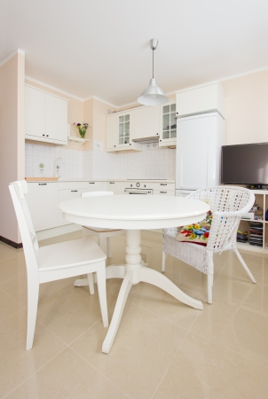 empty  modern white kitchen with dining table in antique rustique style photo