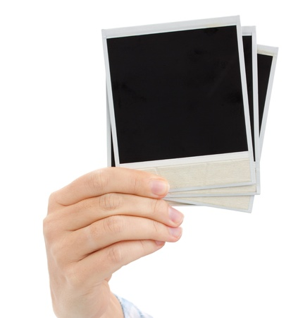 hand holding  instant photo  isolated on white background photo
