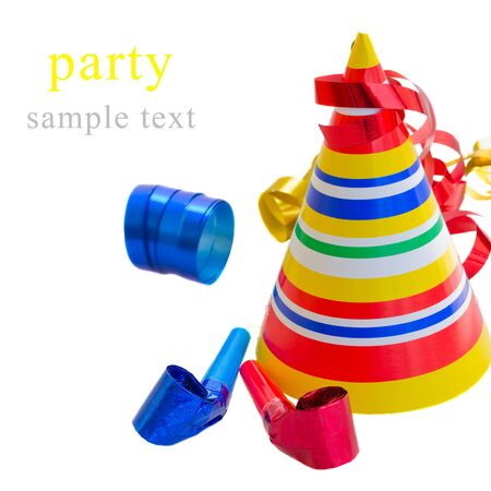 Party Decoration  - hat,  whistle and curling paper isolated on white background Stock Photo - 19315147