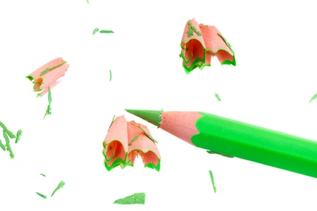 Green pencil with sharpening shavings isolated on white background