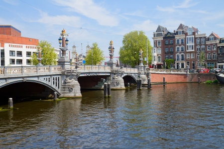 Blue bridge of  Amsterdam on Amstel river, Netherlands Stock Photo - 19667665