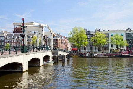amstel river: Magere bridge of  Amsterdam on Amstel river, Netherlands