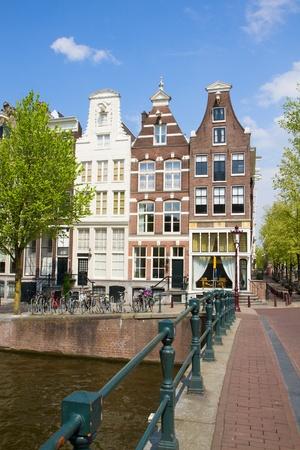 bridge to old houses, Amsterdam, Netherlands Stock Photo - 19667849