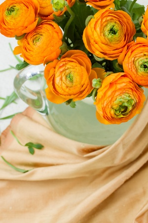 ranunculus orange flowers bouquet on table Stock Photo - 19667887