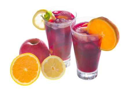 cold sangria in tall glasses with fruits isolated on white background photo