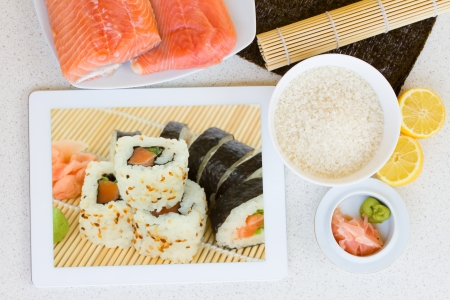 tablet with sushi rolls on display with sushi ingredients Stock Photo - 19668115