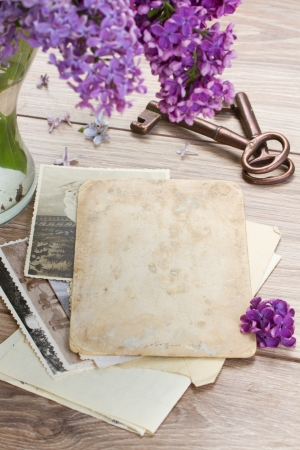 space to write: vintage background  of old photos with keys on a table Stock Photo
