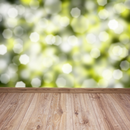 empty wooden planks with green leaves bokeh background photo