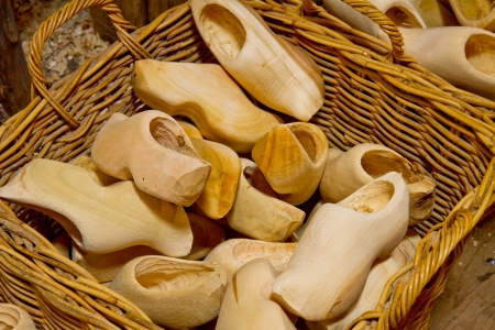 traditional dutch wooden shoes clogs in basket photo