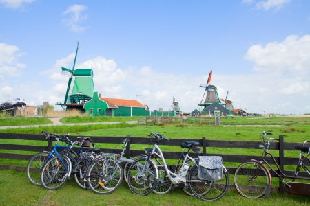 dutch windmills with bikes  in Zaanse Schans, Holland photo