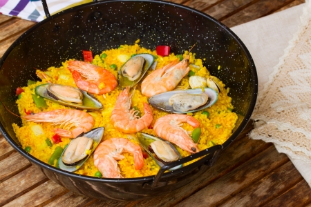 marisco: Paella in black pan  -traditional spanish rice dish
