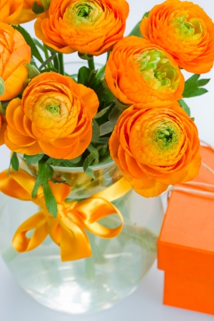 bouquet of orange  ranunculus in glass vase close up Stock Photo - 20285045