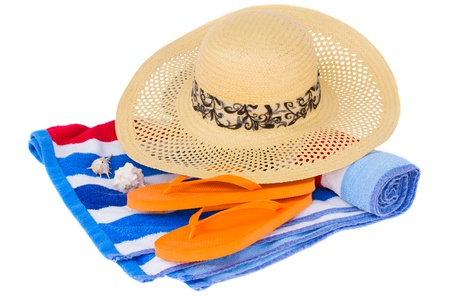 straw hat and beach towel isolated on white background photo