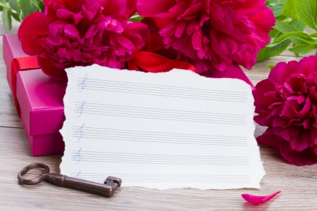 aged notes paper  with key and peony flowers photo