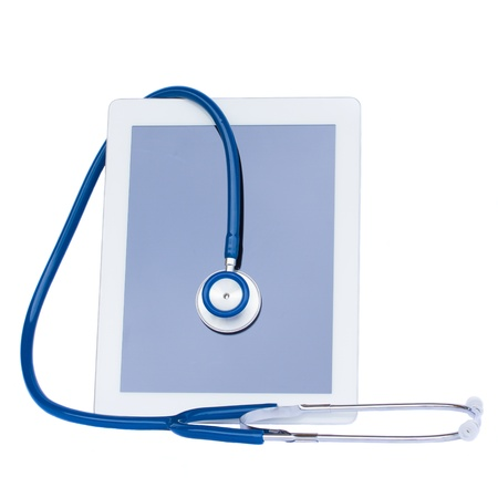 medical tablet with stethoscope isolated on white background photo