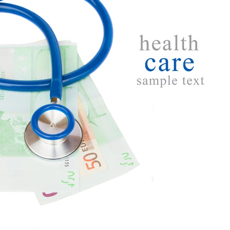 health care costs concept - stethoscope and euro banknotes isolated on white background photo
