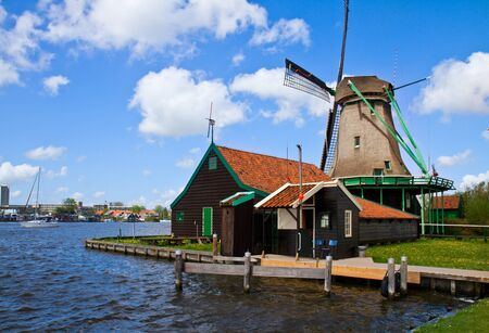 zaan: dutch windmill over Zaan river waters, Netherland