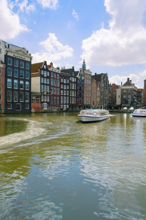 medieval houses and ships over water in Amsterdam, Netherlands photo