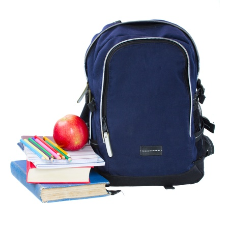 packing supplies: blue school backpack with stationery isolated on white background