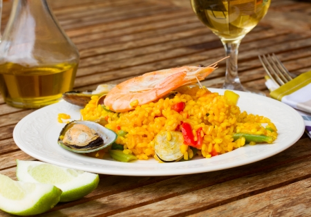 Dining  -  white plate with seafood paella photo