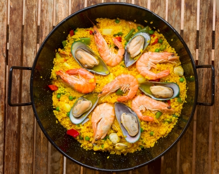 Seafood Paella in black pan  -traditional spanish rice dish photo