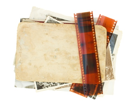 pile of old photos with film isolated on white background photo
