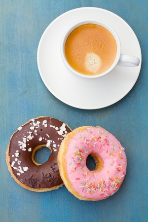 breakfast with fresh donuts and cup of espresso coffee photo