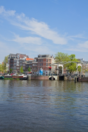 amstel river: Old houses of  Amsterdam on Amstel river, Holland