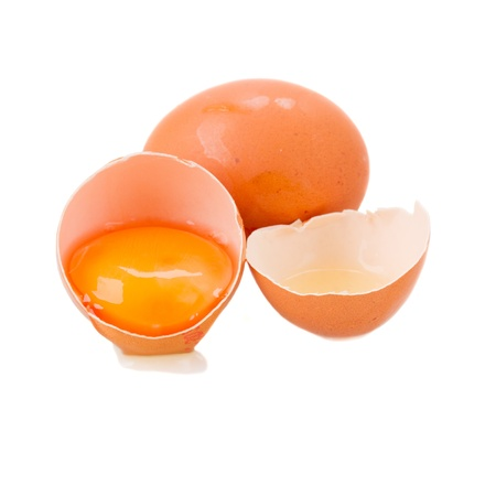 whole and broken raw eggs isolated on white photo