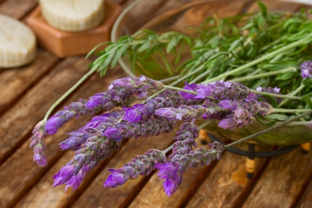 Freshly picked lavender flowers  on wooden table photo