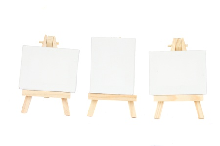 set of easels with blank canvas isolated on white background photo