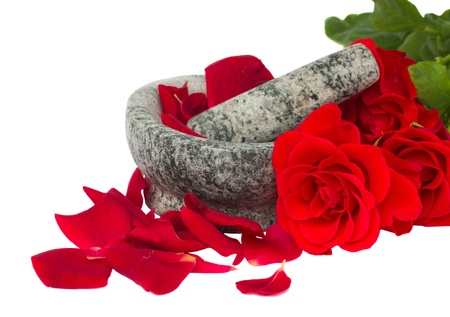 Mortar with red rose фтв petals isolated on white background