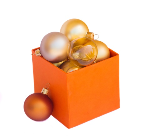 box of golden christmas balls  isolated on white background photo