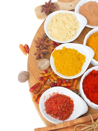 colorful plates of  spices curry, ginger and saffron  isolated on white backgroundle photo