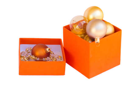 orange box of golbox of golden christmas balls isolated on white background den christmas balls isolated on white background photo