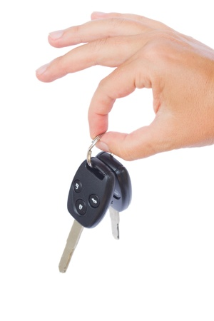 hand holding a car keys isolated on white background photo