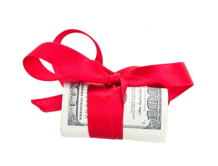 roll of dollars with red bow isolated on white background photo