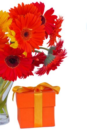gerbera fresh  flowers in glass vase with gift box  isolated on white background Stock Photo - 22230145