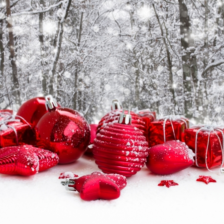 snowed: red christmas balls in snowed  winter forest Stock Photo