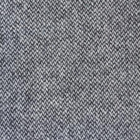 Tweed fabric herringbone texture, wool pattern close up photo