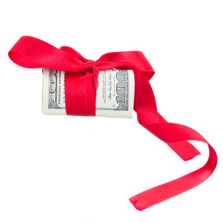roll of dollars with red bow  and ribbon isolated on white background photo