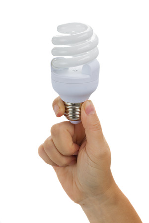 electric fixture: hand holding energy saving  electric bulbs isolated on white background