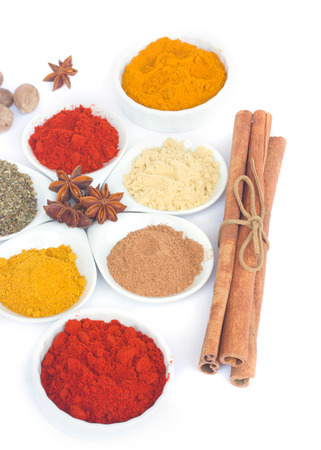 set of spices cucurma, pepper, cinnamon, curry and anise  isolated on white photo