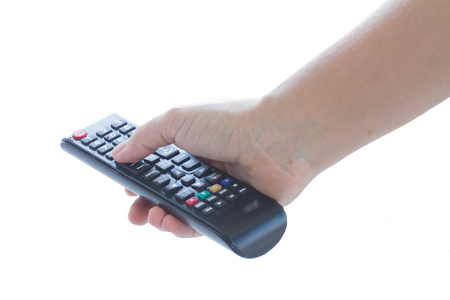 female hand holding TV remote control isolated on white background Banco de Imagens - 22643115
