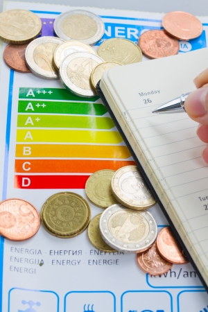 save heating costs: Energy efficiency expences concept with energy rating chart