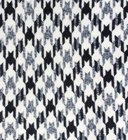 Tweed fabric houndstooth texture, wool pattern close up